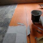 220 qm Granit 30,5 x60 cm auf einer Entkopplungsmatte verlegt