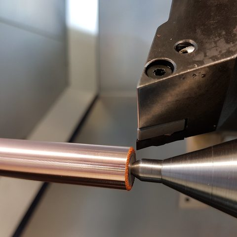 Kaltgasspritzen - Bolzen mit dicker Kupferschicht im Kaltgasspritzverfahren beschichtet und glatt nachgedreht